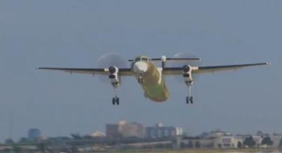 Bombardier-Q400-Extra-Capacity-First-Flight-0714a